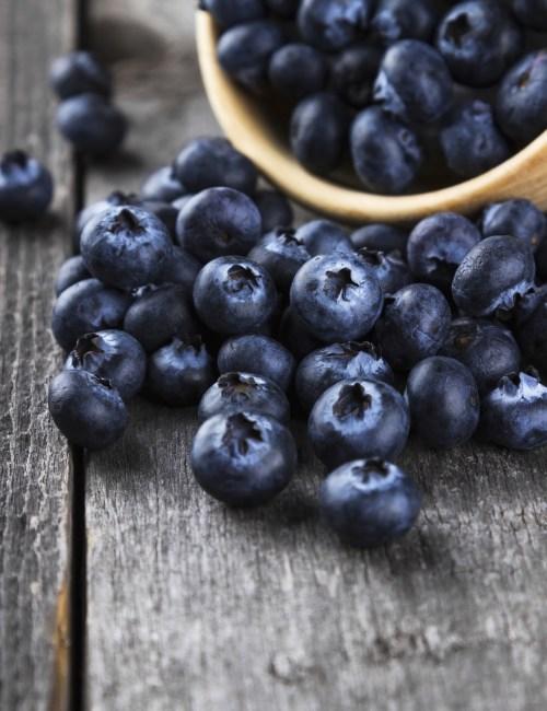 Blueberry on a dark wooden background