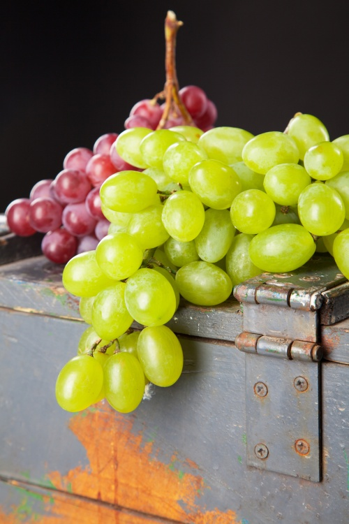 Grapes on a wooden crate