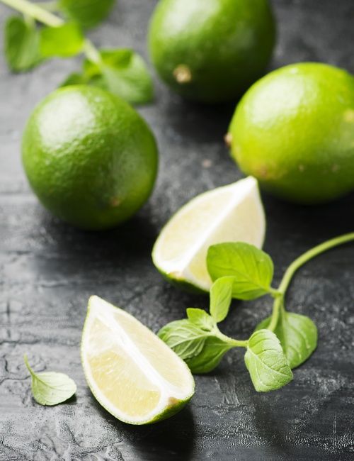 Fresh lime and mint on the black table